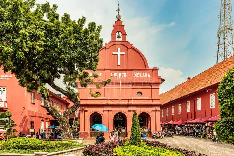 Christ church at Dutch square in Malacca, Melaka, Malaysia. Malacca, Malaysia – Dec 15, 2017: Tourists in front of Christ church at Dutch square in royalty free stock photos