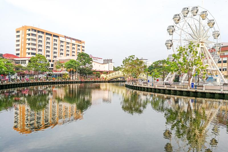 Malacca, Malaysia, April 8, 2018: Malacca city is awarded the UN. ESCO World Heritage City status with rich history. Featured here is Melaka River next to Eye of royalty free stock images