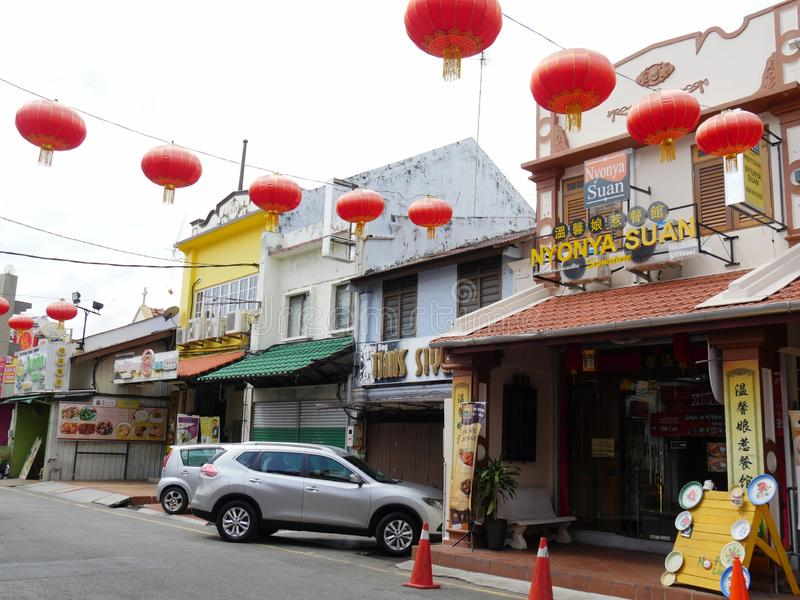 Malacca, Malaysia--February 2018: Close view of some of the business establishments and fastfoods at Jonker Street decorated with stock images