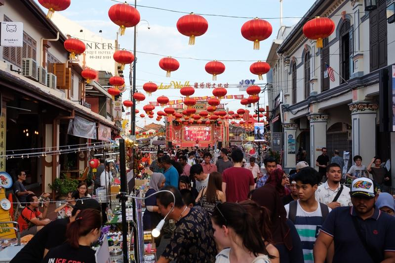 MALACCA, MALAYSIA - FEBRUARY 03, 2018 : The Jonker night market is opening. many street shops and crowd of people royalty free stock photography