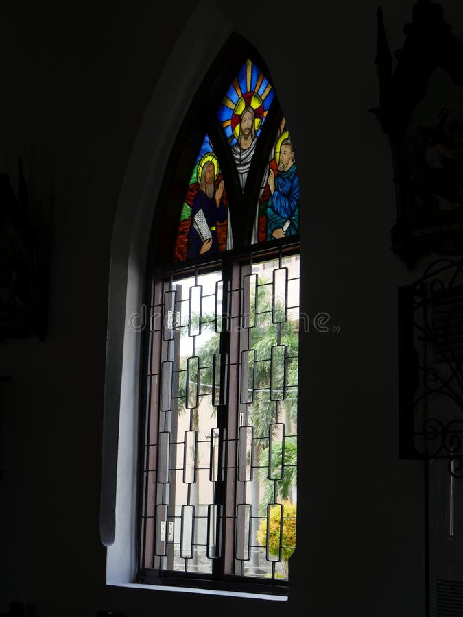 Malacca, Malaysia--February 2018: Side view of a glass-stained window from inside St. Peter's Church, the oldest church in. Malaysia stock photography
