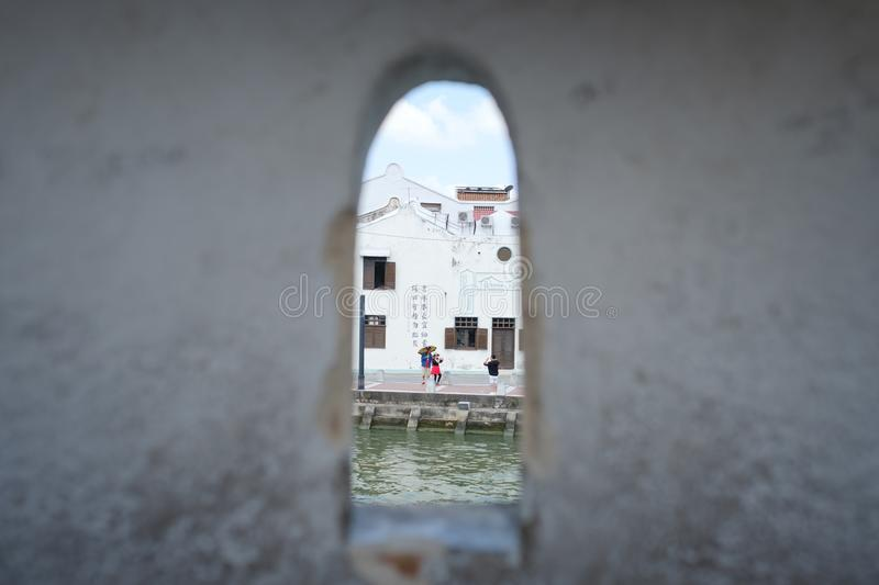 MALACCA, MALAYSIA - FEBRUARY 04, 2018: tourists making photo for memories on street royalty free stock photo