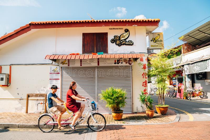 Malacca old town street and Tourist people on bicycle in Malacca, Malaysia stock photos
