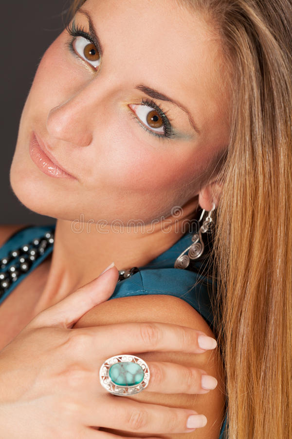 Malachite beauty. Close-up portrait of a beauty with malachite ring royalty free stock photo