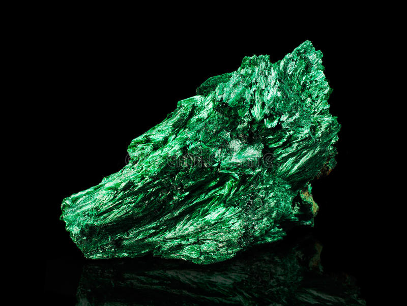 Malachite. On a black background royalty free stock photos