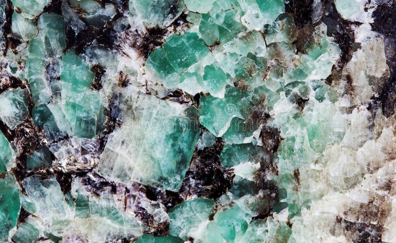 Malachite in mica group of sheet silicate minerals. Natural decorative stone texture pattern macro view. royalty free stock image