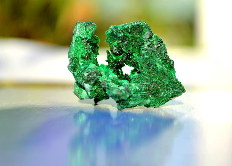 Malachite mineral. Malachite, with its beautiful, rich green color, leaves no doubt of its importance as a jewel. Its opaque strength and power demands respect royalty free stock photo