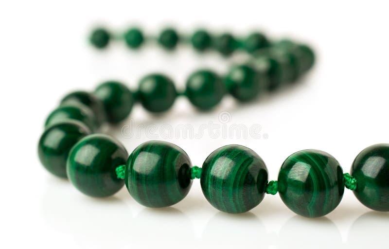 Malachite necklace. Isolated on white royalty free stock photo