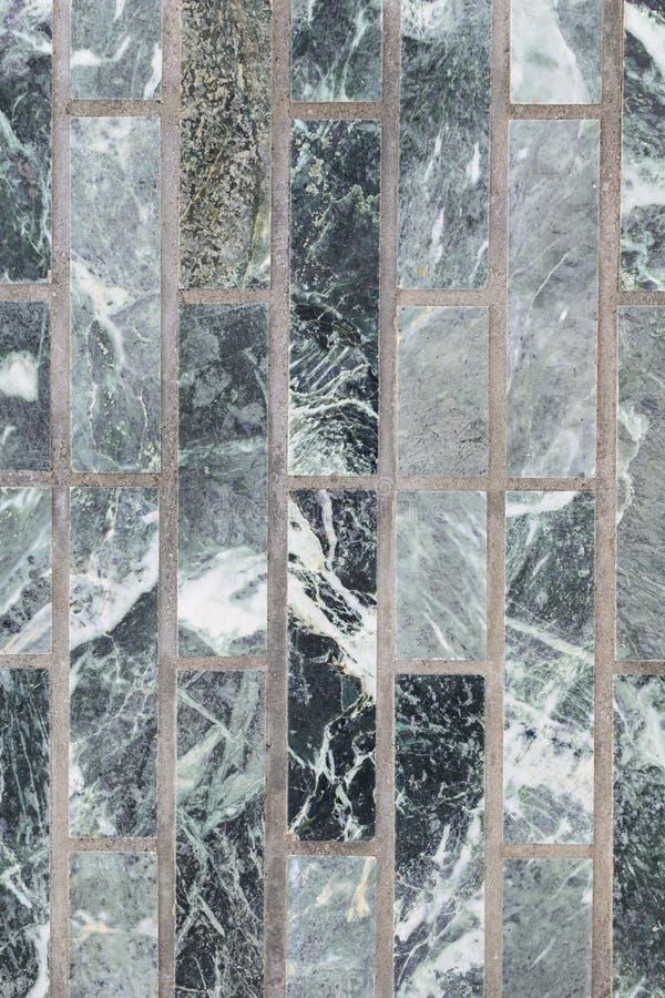 Malachite wall green for backdrop. A wall of malachite stone for texture stock photos