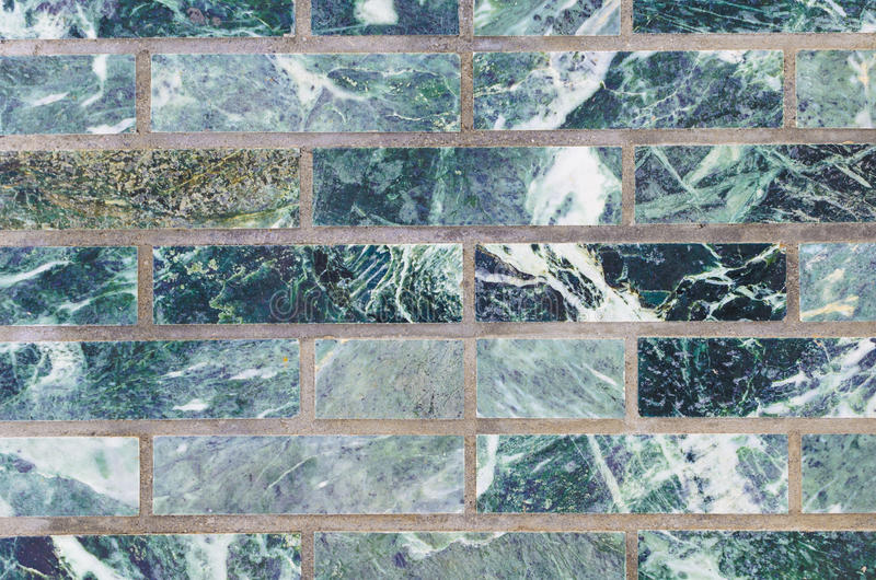 Malachite wall green for backdrop. A wall of malachite stone for texture royalty free stock photos