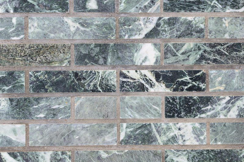 Malachite wall green for backdrop. A wall of malachite stone for texture royalty free stock image
