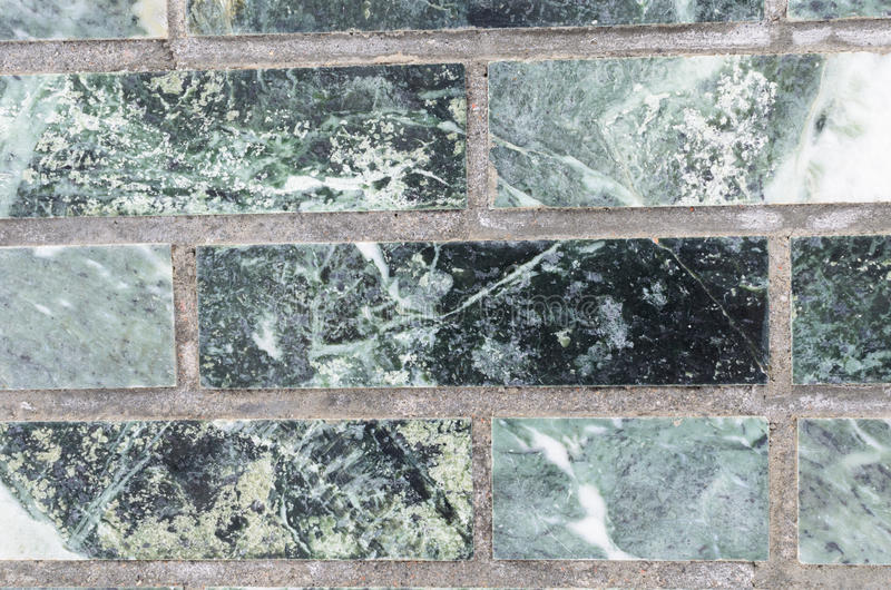 Malachite wall green for backdrop. A wall of malachite stone for texture royalty free stock photo