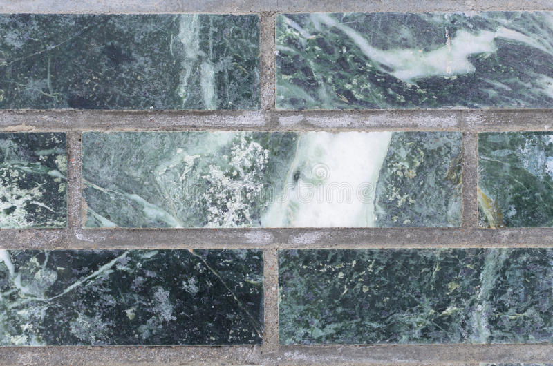 Malachite wall green for backdrop. A wall of malachite stone for texture royalty free stock images