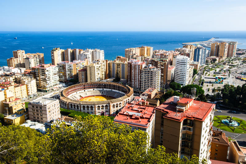 Malaga bullring and port. View of Malaga bullring and port from height of Castillo de Gibralfaro stock photography