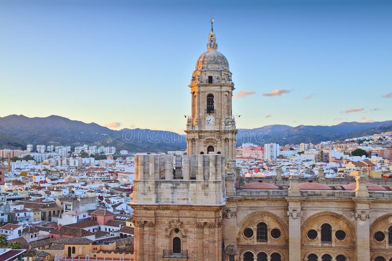 Malaga Cathedral at sunset. Aerial view of Malaga and detail of the Cathedral. Spain stock photo