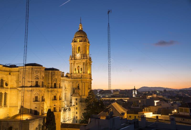 Malaga Cathedral after sunset. Malaga cathedral illuminated at dusk stock photos