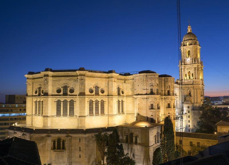 Malaga Cathedral after sunset. Malaga cathedral illuminated at dusk royalty free stock photos