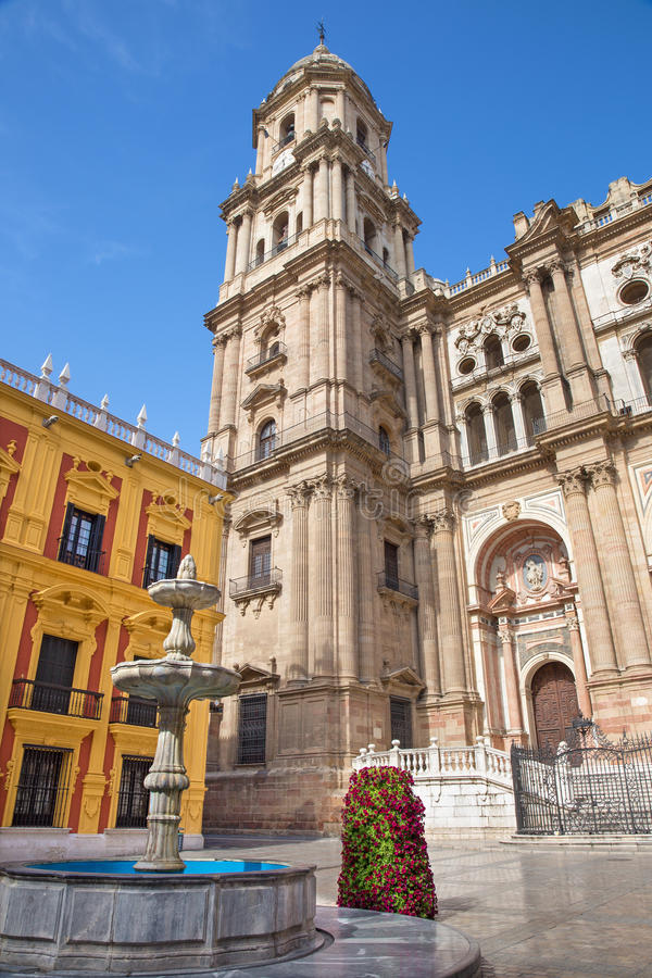 Malaga - Cathedral tower and fountain from Plaza del Obispo. Malaga - The Cathedral tower and fountain from Plaza del Obispo stock photography