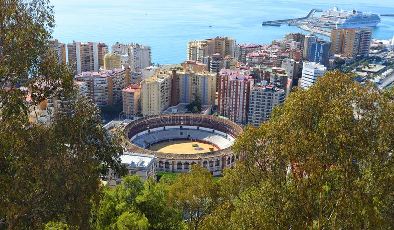 Malaga City Bull Ring Plaza de Toros or La Malagueta. Viewed from above with tower blocks harbour and the Ocean in background stock image