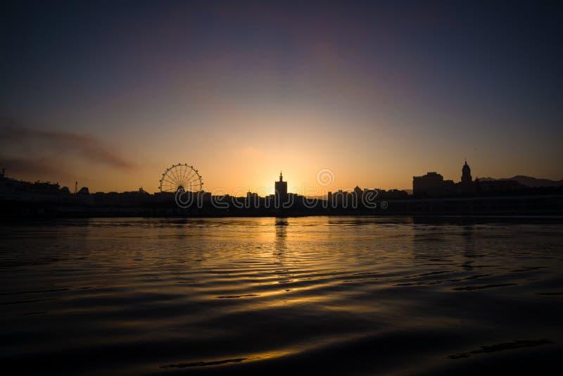 Sea Malaga Harbor City Panorama with sunset at night royalty free stock photo