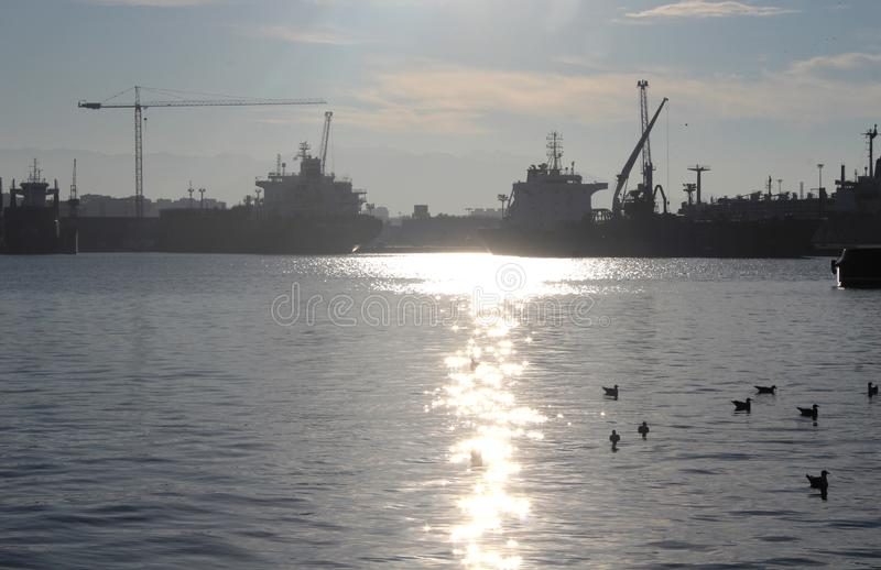 Malaga port at sunset royalty free stock image