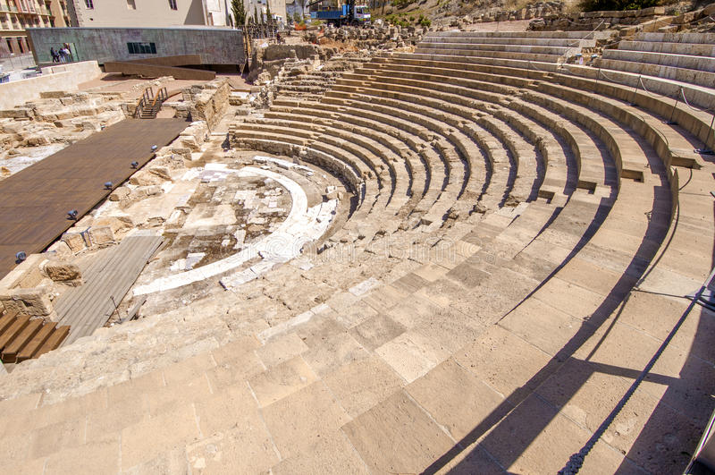 MALAGA, SPAIN- AUGUST 23, 2014: Ancient Roman Theatre near Malaga Alcazaba castle on Gibralfaro mountain, Andalusia, Spain. The p. Lace is declared UNESCO World royalty free stock photo