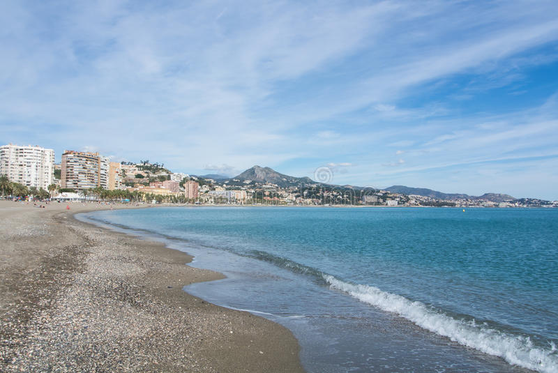 MALAGA, SPAIN - FEBRUARY 7, 2017: A view to Malaga and its hotels, resorts and mountains and Mediterranean sea stock photography