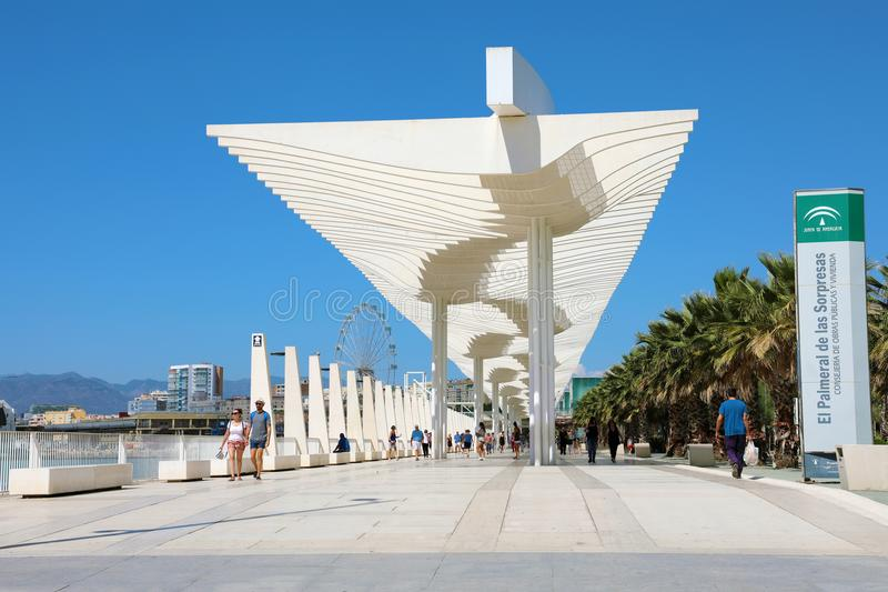 MALAGA, SPAIN - JUNE 13, 2018: white pergola and palm trees along Malaga port promenade in Andalusia, Spain royalty free stock photos