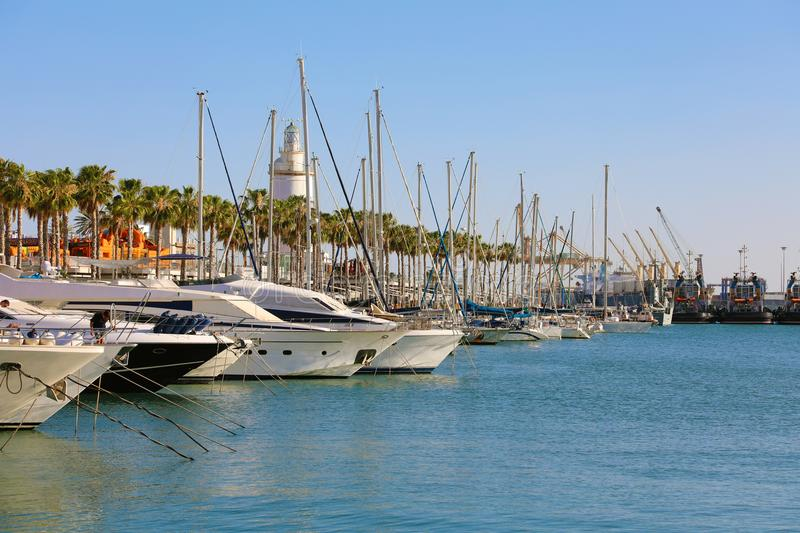 MALAGA, SPAIN - JUNE 12, 2018: yachts in Malaga port with palm trees and lighthouse on the background, Costa del Sol, Andalusia stock photo