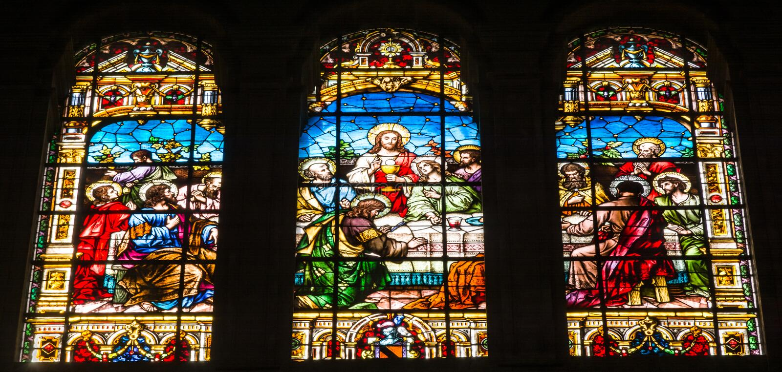 The Last Supper scene on stained glass windows in Malaga Cathedral. Malaga, Spain - March 5, 2017: The Last Supper scene on stained glass windows in Malaga stock photography