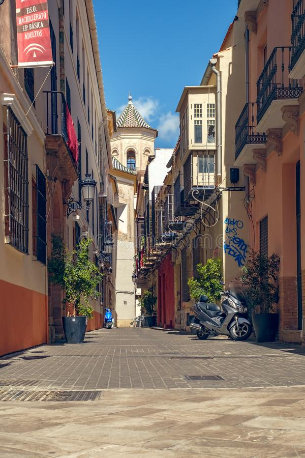 Malaga old street with historic buildings. stock photos