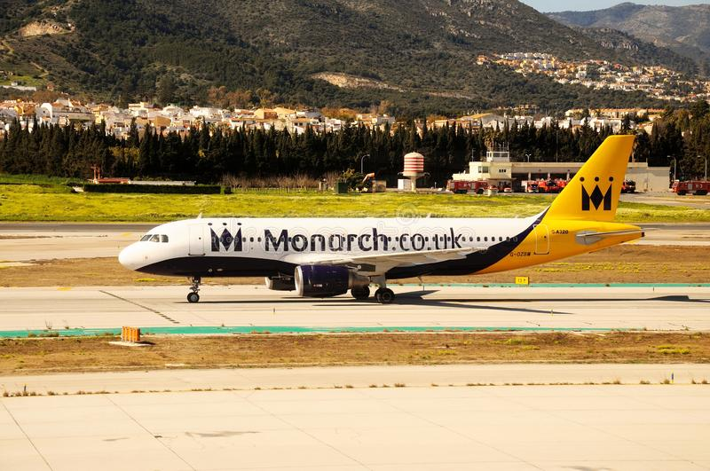 Monarch Airbus A320, Malaga, Spain. Monarch Airlines Airbus A320 taxiing at the airport, Malaga, Spain, Europe royalty free stock photography