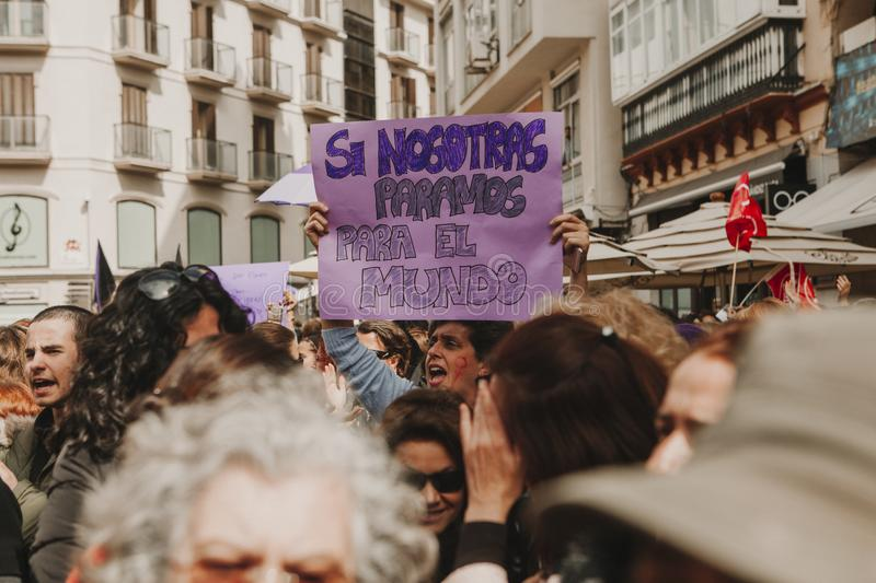 MALAGA, SPAIN - MARCH 8, 2018: Thousands of women take part in the Feminist Strike on the Women Day in the city center of Malaga. On March 8th the women from royalty free stock image