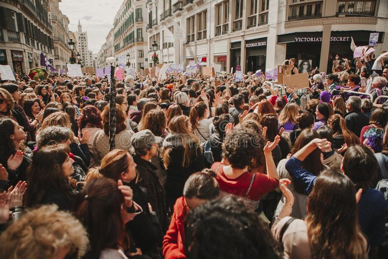 MALAGA, SPAIN - MARCH 8, 2018: Thousands of women take part in the Feminist Strike on the Women Day in the city center of Malaga. On March 8th the women from royalty free stock photo