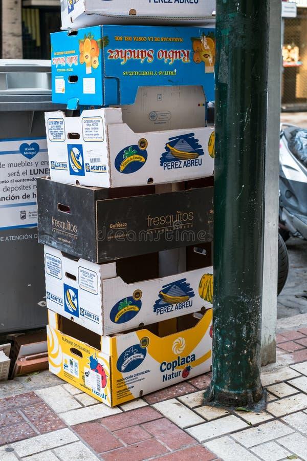 Empty cardboard boxes bananas and tropical fruits stock photos