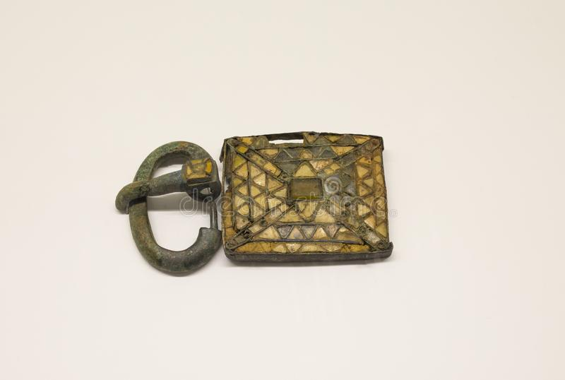 Visigothic belt plate and buckle decorated with cloisonne vitreous paste royalty free stock image