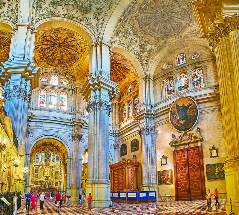The chapels in Malaga Cathedral, Spain. MALAGA, SPAIN - SEPTEMBER 26, 2019: Interior of the beautiful historical Cathedral with complex stone decorations royalty free stock photo
