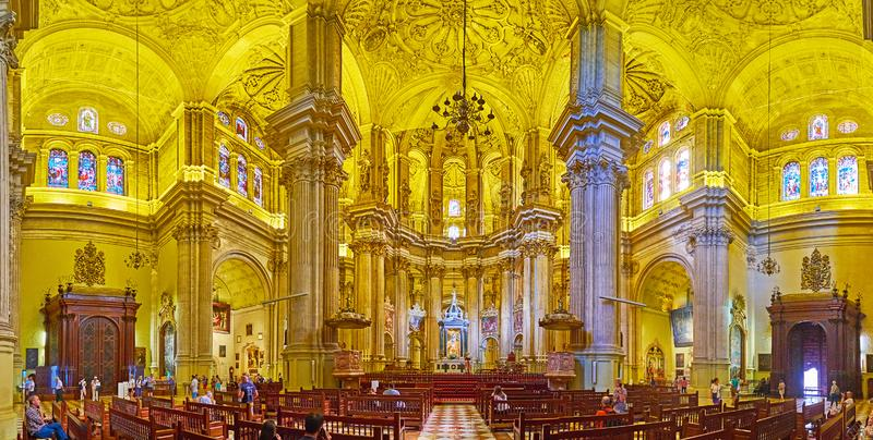 Panorama of Malaga Cathedral, Spain. MALAGA, SPAIN - SEPTEMBER 26, 2019: Panorama of Cathedral interior with tall slender column groups, intricate patterns on royalty free stock photo