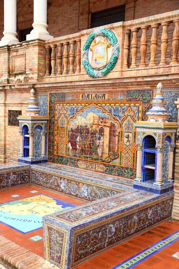 Malaga tiles decor. SEVILLE, SPAIN - NOVEMBER 3, 2012: Malaga theme detail of famous Plaza de Espana in Seville. The Renaissance revival and art deco styles royalty free stock image
