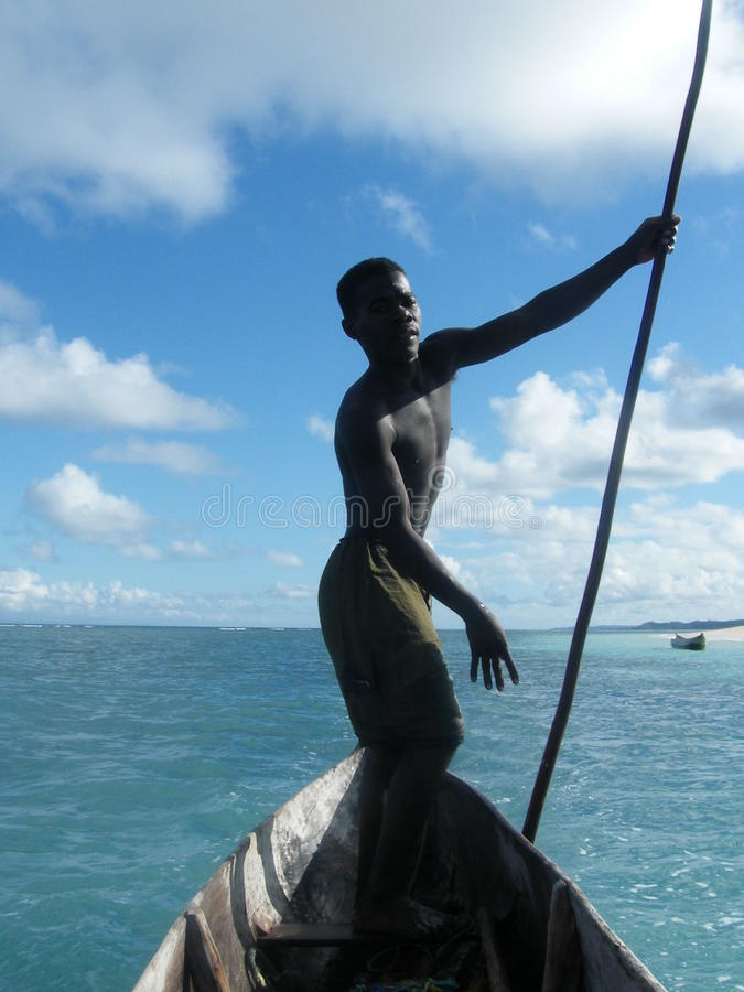 Malagasy native boatman. With whom I was taking a cruise in the island called Nosy Be stock images