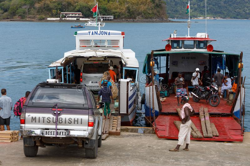 Malagasy peoples loading ship in Nosy Be, Madagascar royalty free stock photography