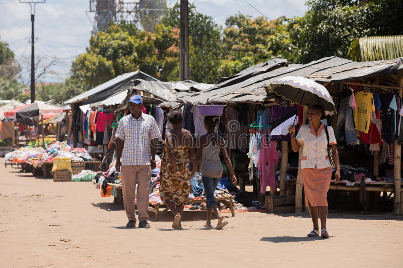 Malagasy peoples on marketplace in Madagascar. MAROANTSETRA ,MADAGASCAR OCTOBER 18.2016 Malagasy peoples on big colorful rural marketplace on main street of royalty free stock photography