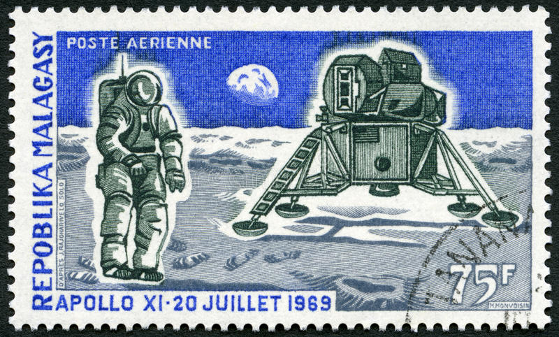 MALAGASY REPUBLIC - 1969: shows Apollo 11 Lunar Landing Module and Man on the Moon. MALAGASY REPUBLIC - CIRCA 1969: A stamp printed in Malagasy Madagascar shows stock photo