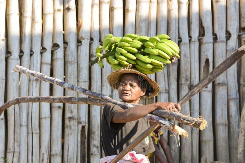 Malagasy woman with bananas stock photos