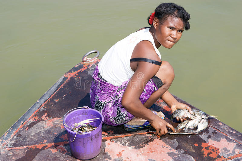 Malagasy woman and fishes royalty free stock photos