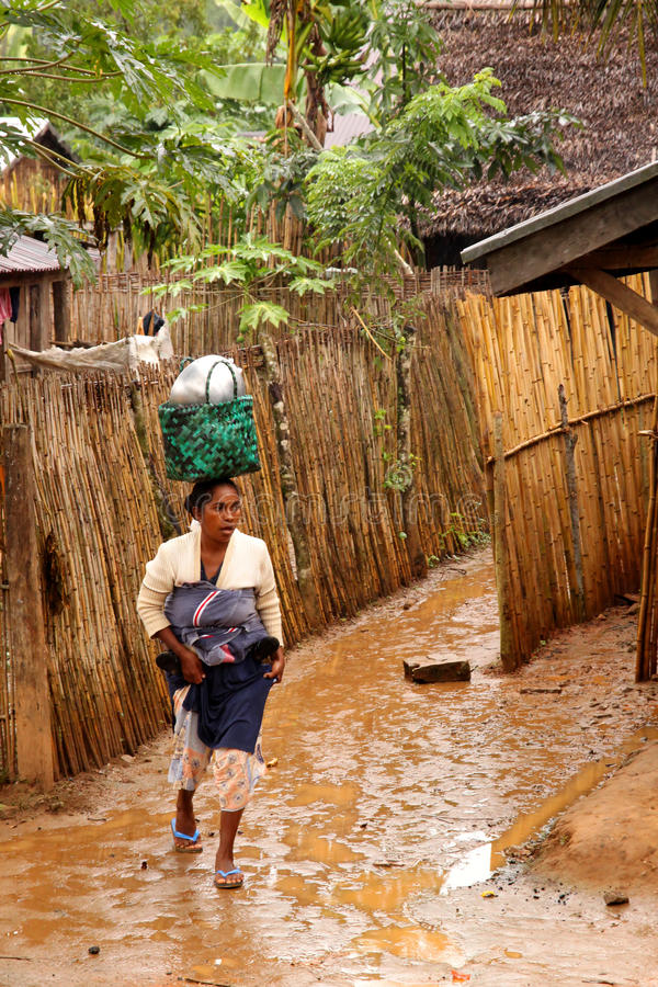 Malagasy woman in the rain stock photography