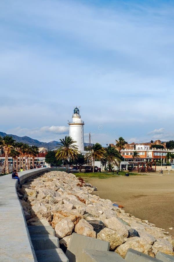 Malagueta beach and lighthouse. Malaga city, Spain stock images