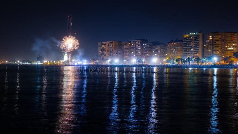 The Malagueta beach at night time with fireworks. In Malaga, Spain royalty free stock images