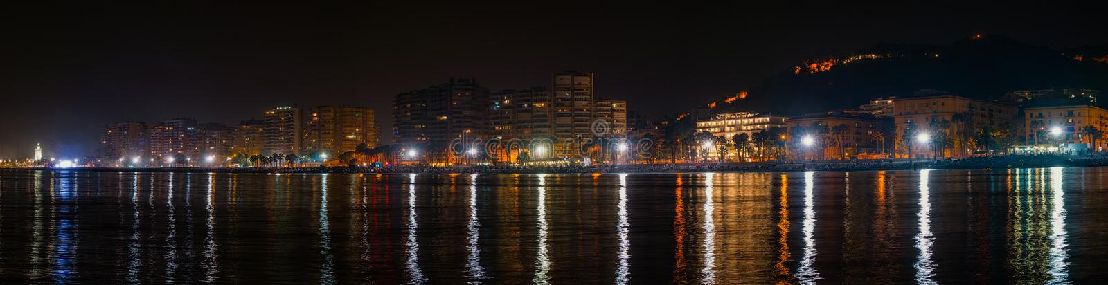 The Malagueta beach at night time in Malaga, Spain. Panoramic view royalty free stock images