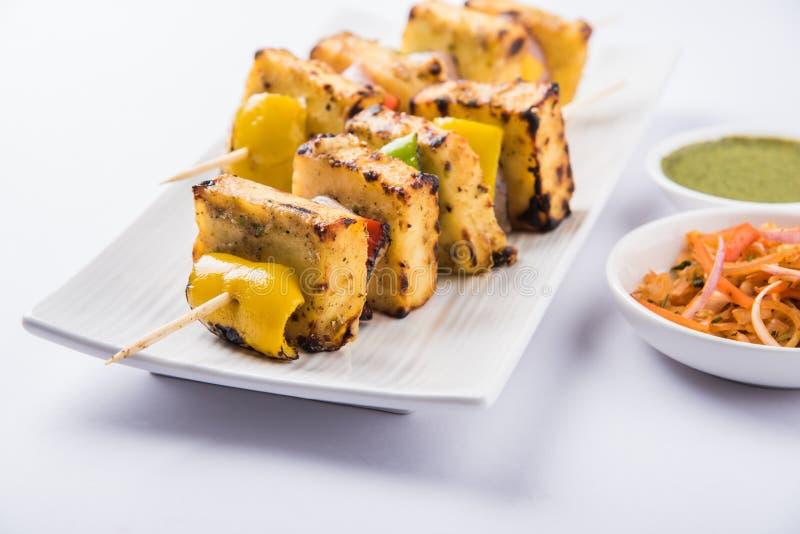 Malai paneer tikka or creamy cottage cheese barbecue. Paneer Tikka Kabab - Tandoori Indian cheese skewers, malai paneer tikka / malai paneer kabab, chilli paneer royalty free stock photo